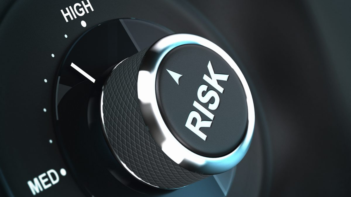 Button with the word risk pointing between medium and high level, 3D render suitable for risk management or decision-making process situation. Depth of field.